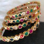 Золотые браслеты наваратна